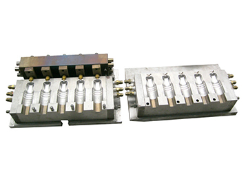Injection blow mould