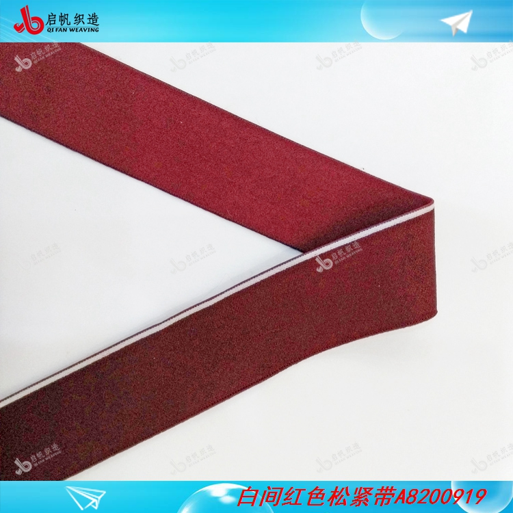 Red elastic band between white