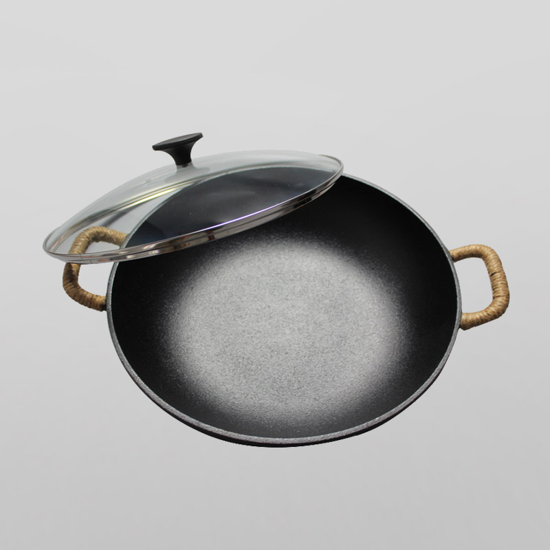 Cast iron wok with two loop handles