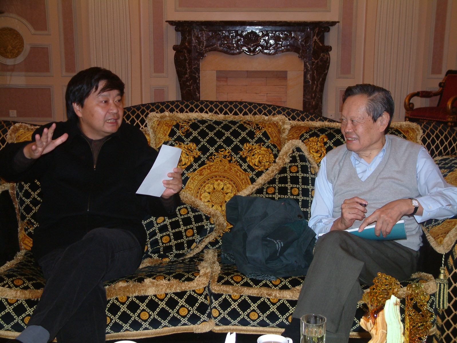 Mr. Yongyan Liu and Zhenning Yang discussing poetry