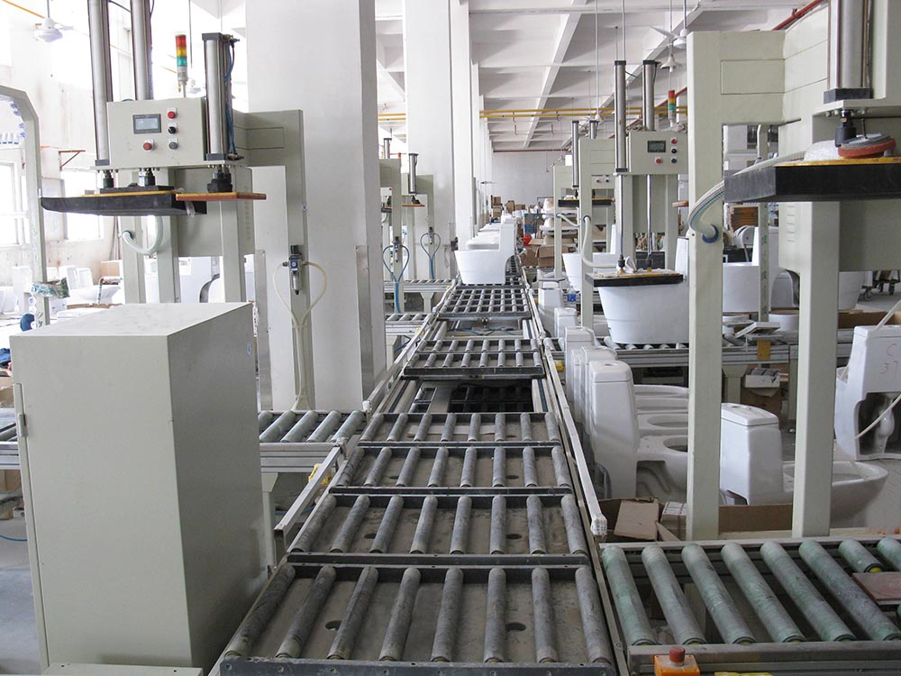 AUTOMATIC INSPECTION AND PACKAGING LINE FOR SANITARY WARE